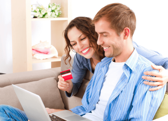 couple doing with credit card and laptop